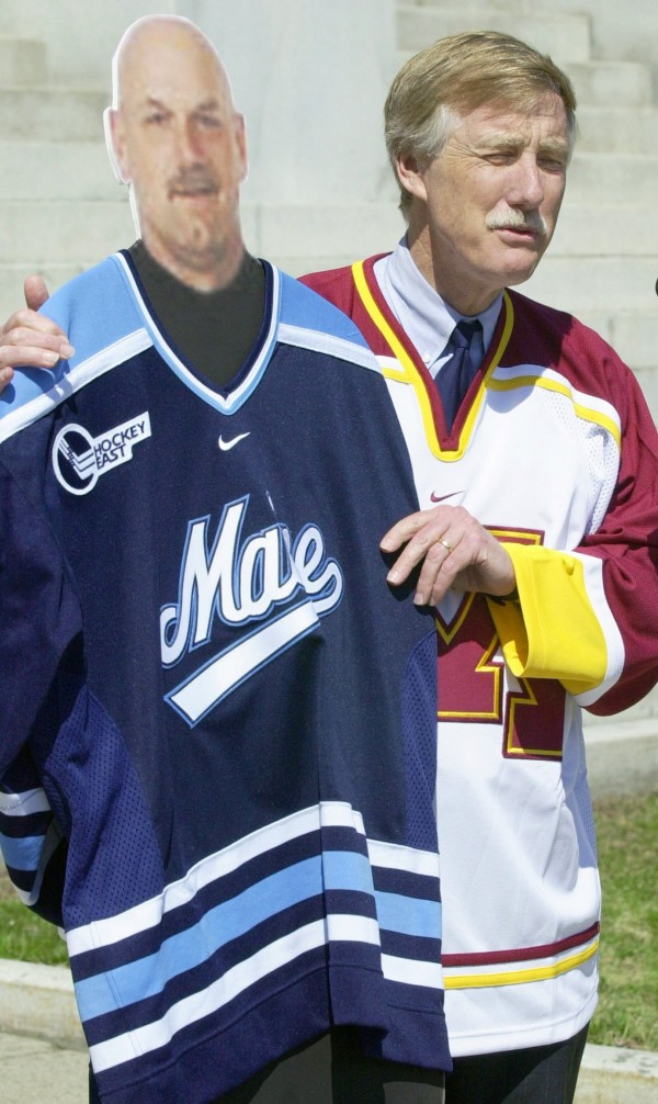 Maine Gov. Angus King, wearing a Minnesota Golden Gophers hockey jersey, poses with a cardboard cutout of Minnesota Gov. Jesse Ventura on the State House steps in Augusta on Thursday, April 11, 2002. King posed in the jersey after making a wager with Ventura over last weekend's NCAA hockey championship games between the Black Bears and Gophers.