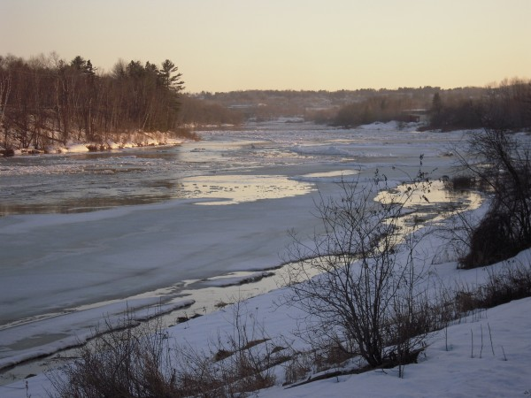 On March 20 rapidly flowing water was carving a dark channel through the ice on the Aroostook River in front of my house.