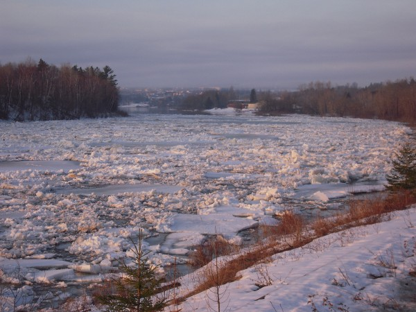 The ice was still resisting the open water upstream between the dam and my house when I awoke March 21.