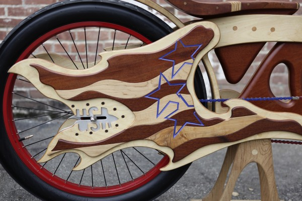 Bill Holloway cruises on one of his hand-built wooden bicycles at his San Jose, California, shop on March 13, 2012. Holloway and his partner, Mauro Hernandez, run Masterworks Wood and Design, offering &quotart that you can ride.&quot