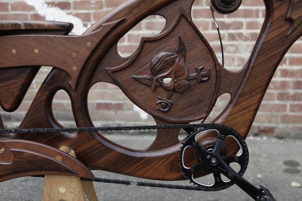 A pirate carving adorns a hand-built wooden bicycle at Masterworks Wood and Design in San Jose, California, on March 13, 2012. The company offers &quotart that you can ride.&quot