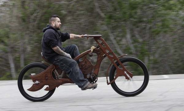 Mauro Hernandez cruises on one of his hand-built wooden bicycles at his San Jose, California, shop on March 13, 2012. Hernandez and his partner, Bill Holloway, run Masterworks Wood and Design, offering &quotart that you can ride.&quot
