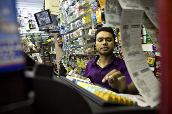 "Ali Ahmed prints lottery tickets for a customer in New York in 2009. Georgia, Massachusetts and New York rank first, second and third, respectively, on Bloomberg's ""Sucker Index"" of states spending the most money on games that have the worst odds of any form of legal gambling. Maine ranks 17th."