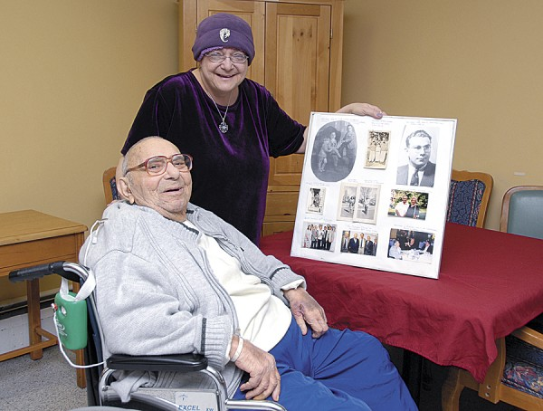 "Howard Weiner shares a chuckle with his daughter, Rachael Daigle of Stetson, as they celebrate his 23rd birthday at Brewer Rehab and Living Center on Wednesday, Feb. 29. While Weiner actually turned 92, he said that ""I don't celebrate other years"" that lack a Leap Year Day. Daigle holds a photo collage that she made of her father's life."