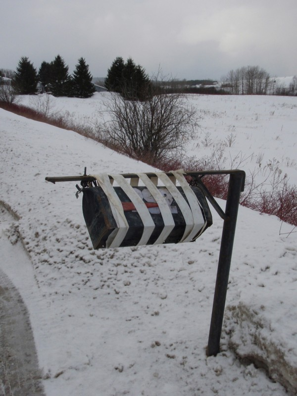 Pictured is a poor black box whose owner has duct-taped to the post, probably several times, in a determined effort to make it through the winter.