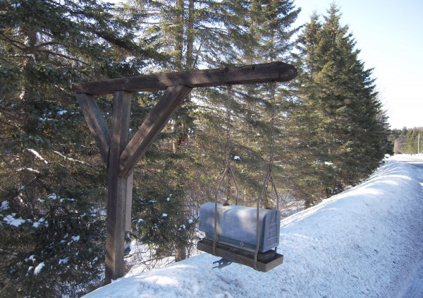 Among the inventive ideas that can be seen just off various roads in The County is this sturdy wood structure anchored a safe distance from the road, with adjustable chains suspending the mailbox above the snow.
