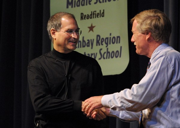 Maine Gov. Angus King, right, greets Apple CEO Steve Jobs, during a visit to Portland high School, Monday, June 10, 2002, in Portland, Maine.