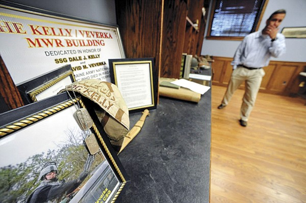Displayed in the new Infantry Memorial Room at the Brewer Armory are memorabilia recalling two Maine Army Guardsmen killed in Iraq on May 6, 2006. Bangor resident Darryl Lyon (background), who was their commander, is a director of the Maine Infantry Foundation, which has established a charitable arm to assist Maine infantrymen and their families.