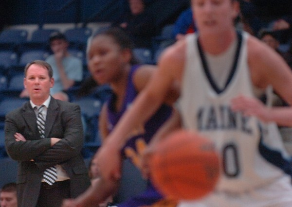 University of Maine women's head coach Richard Barron watches UMaine's Samantha Baranowski (50) evade a University at Albany opponent during a game in January. Barron hopes this season will begin to change the perception of UMaine women's basketball as a cellar-dweller, a once-mighty program that has fallen on hard times.