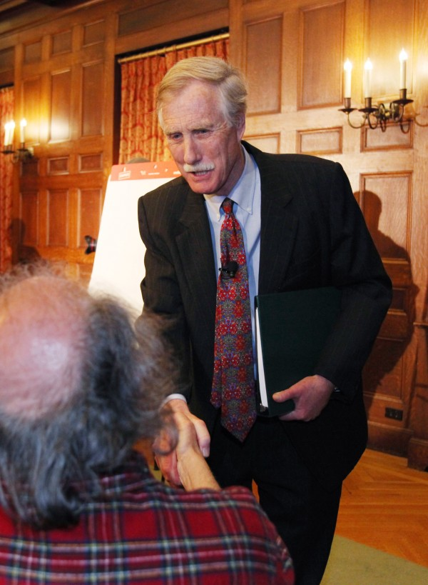 Former Gov. Angus King greets a supporter Monday, March 5, 2012, at Bowdoin College in Brunswick, Maine. King announced plans to run as an independent for the seat being vacated by Sen. Olympia Snowe, R-Maine.