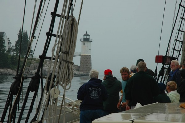 The schooner Mary Day with passengers as they pass Robinson Point Light. The Mary Day celebrates its 50th birthday this year.