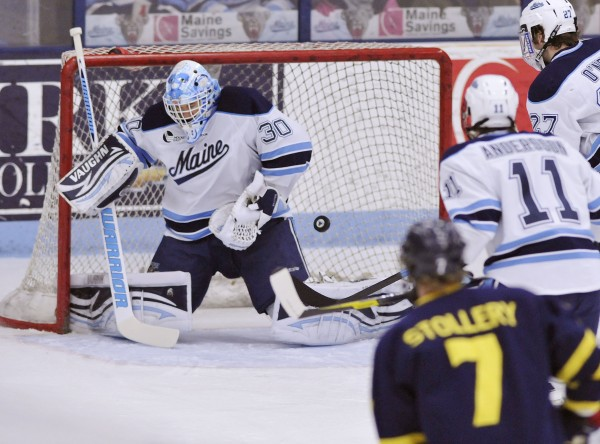Maine goalie Dan Sullivan (30) makes a pad save in the first period of a Hockey East quarterfinal against Merrimack in Orono, Maine, Saturday, March 10, 2012.