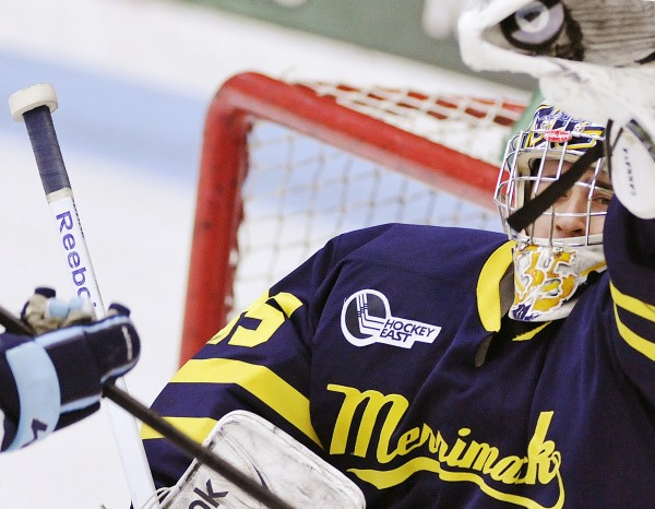 Merrimack goalie Joe Cannata (35) makes a glove save in the first period of a college hockey game against Maine on Sunday, March 11, 2012, in Orono.