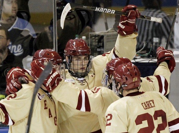 Boston College's Chris Kreider, center, is surrounded by teammates as he celebrates his second goal during the third period of BC's 2-0 win over Air Force in an NCAA Northeast Regional college hockey game in Worcester, Mass., Saturday, March 24, 2012.