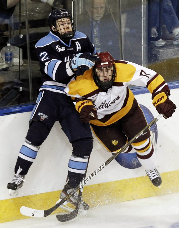 Maine's Mike Cornell, left, collides with Minnesota-Duluth's Mike Seidel during the second period of an NCAA Northeast Regional college hockey game in Worcester, Mass., Saturday, March 24, 2012.