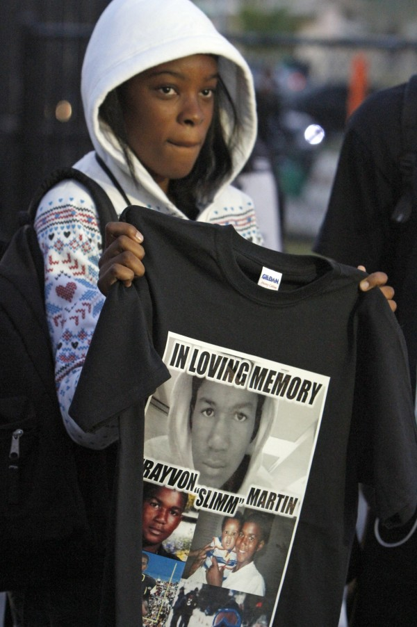 Francesca Placide, a student at Michael Krop High School displays her black t-shirt in tribute to Trayvon Martin, Monday, March 26, 2012, in Miami.