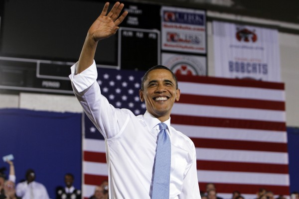 President Barack Obama waves to the crowd after speaking about health care reform during an event at the Portland Expo Center, in Portland, Maine, Thursday, April 1, 2010.