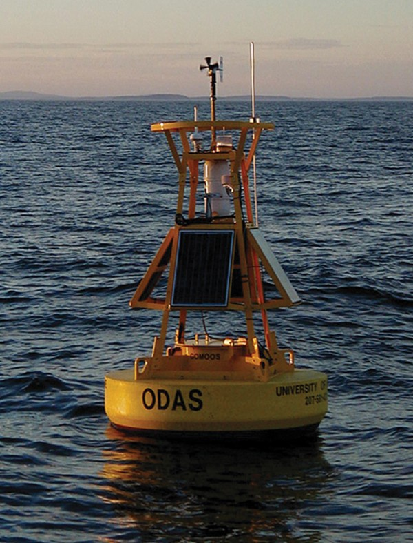 In this undated file photo provided by the University of Maine, a weather buoy is seen in Penobscot Bay off the coast of Maine. Water temperatures at all seven buoys monitored by the Northeastern Regional Association of Coastal and Observing Systems in the Gulf of Maine have been increasing over the past several years.
