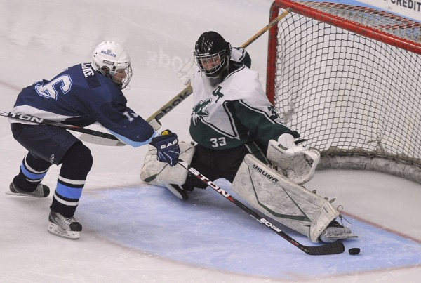 Old Town goalie Nathan Colannino makes a save on a shot by Presque Isle's Isaac LaJoie during a game earlier this season. Colannino will lead Old Town against Brewer in an Eastern Maine Class B semifinal 8 p.m. Saturday at Sukee Arena in Winslow.