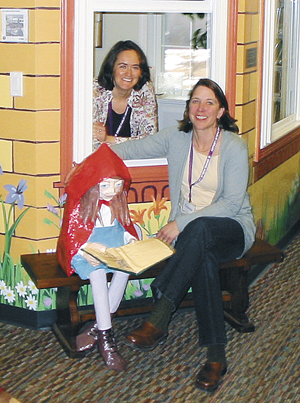 Louise Jolliffe (left), Youth Services librarian, and Laurie Carpenter, library director, relax in the Orono Public Library's children's area.