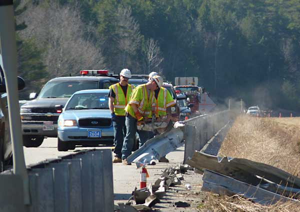 Workers repair damage caused when the tractor-trailer careened off Interstate 295 on Wednesday, March 21, 2012.