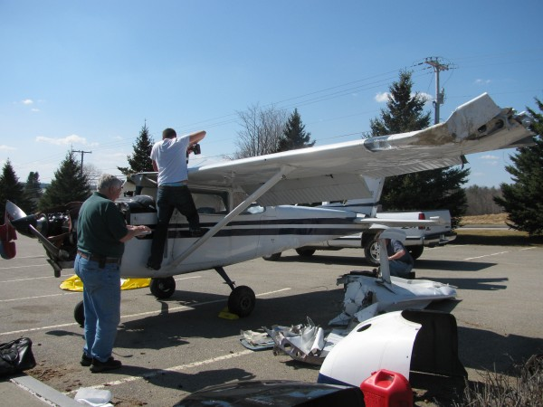 A crew from Columbia Air Service in Trenton worked Wednesday to dismantle a single-engine Cessna that crash-landed on Route 52 the previous night.