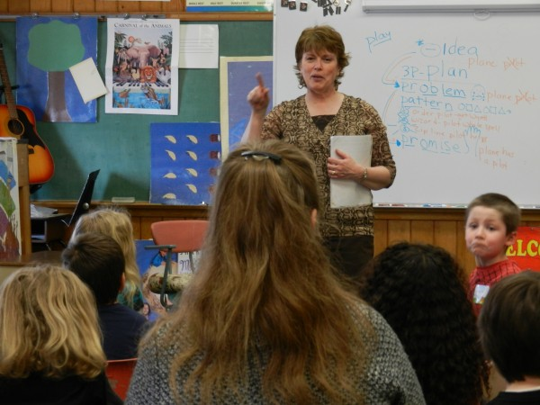 Maine children's author Lynn Plourde speaks to Jo Clark's second-grade class Tuesday afternoon, March 13, 2012, at Vine Street School in Bangor. The Skowhegan native visited the school to share stories with children and encourage reading both with the students and their families.