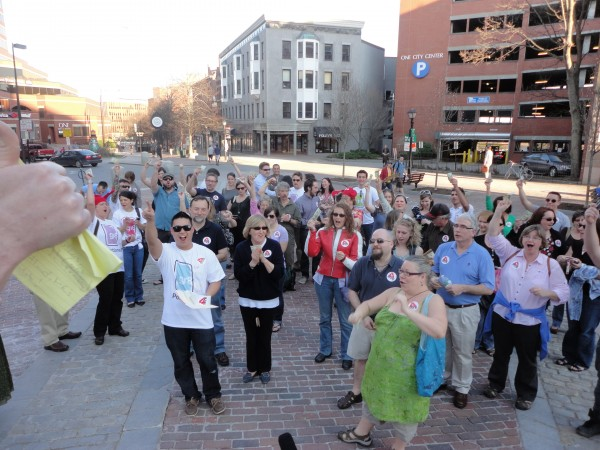 Participants in Portland's first Cash Mob hold up their $20 bills before marching from Monument Square to Longfellow Books nearby. In the Thursday, March 22, 2012, event, nearly 50 people turned out to support the local business.