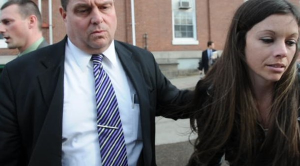 Jerry Perdomo's widow, Tonya Perdomo (right) of Orange City, Fla., is escorted to her car by Maine State Police Detective Brian Strout, a lead investigator on the Perdomo case, after Daniel Porter's Harnish hearing at Waldo County Superior Court in Belfast, Maine Thursday afternoon, March 8, 2012.