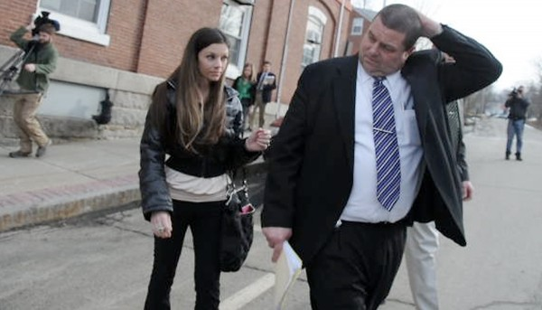 Jerry Perdomo's widow, Tonya Perdomo (left) of Orange City Florida, is escorted to her car by Maine State Police Detective Brian Strout, a lead investigator on the the Perdomo case, after Daniel Porter's Harnish hearing at Waldo County Superior Court in Belfast, Maine Thursday afternoon, March 8, 2012. Justice Robert Murray denied Porter bail.