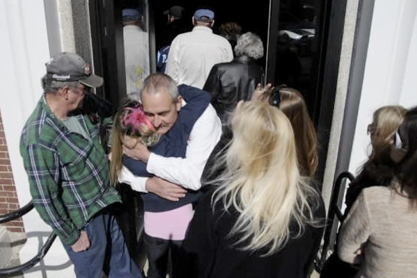 Gary Porter (center) of Jackson hugs a family supporter outside Waldo County Superior Courthouse before the Harnish hearing there for his son Daniel Porter on Thursday afternoon, March 8, 2012. Justice Robert Murray denied Daniel Porter bail.