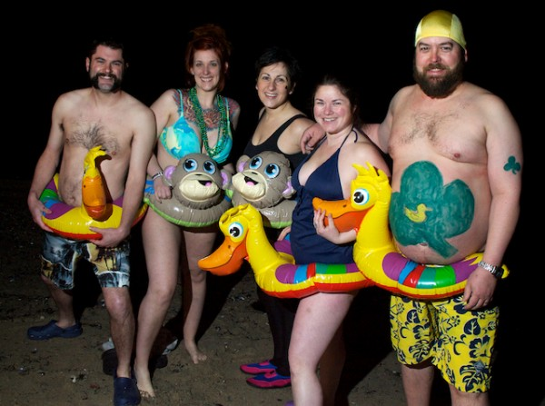 "Team Sham Duck poses for a final picture before plunging into Casco Bay at the East End Beach at 5:30 a.m Saturday, March 17, 2012, with hundreds of others to raise money for the Portland Firefighters Children's Burn Foundation. Team Sham Duck is€"" (from left) Jake Pierson Hillary Coolidge, Jess Murphy, Rori Crossman and Jim Devon. They€"" raised over $1,500."