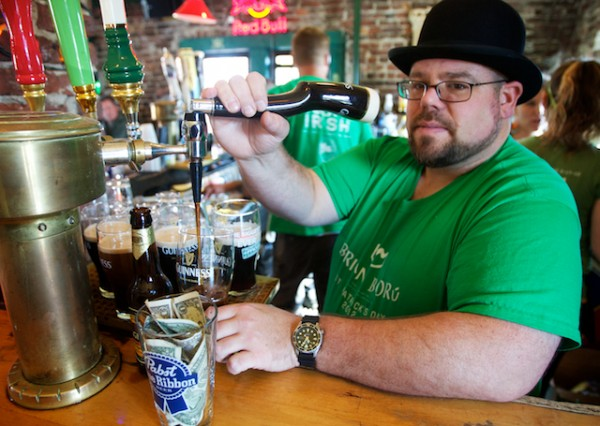 "Longtime bartender at Brian Boru Publick House in Portland, Jeff Dalbec, pours multiple pints of Guinness at once on€"" St. Patrick's Day, Saturday,€"" March 17, 2012."