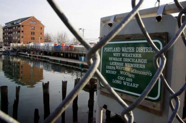 A sign near Long Wharf in Portland marks a wet weather sewage discharge point Monday, March 12, 2012.