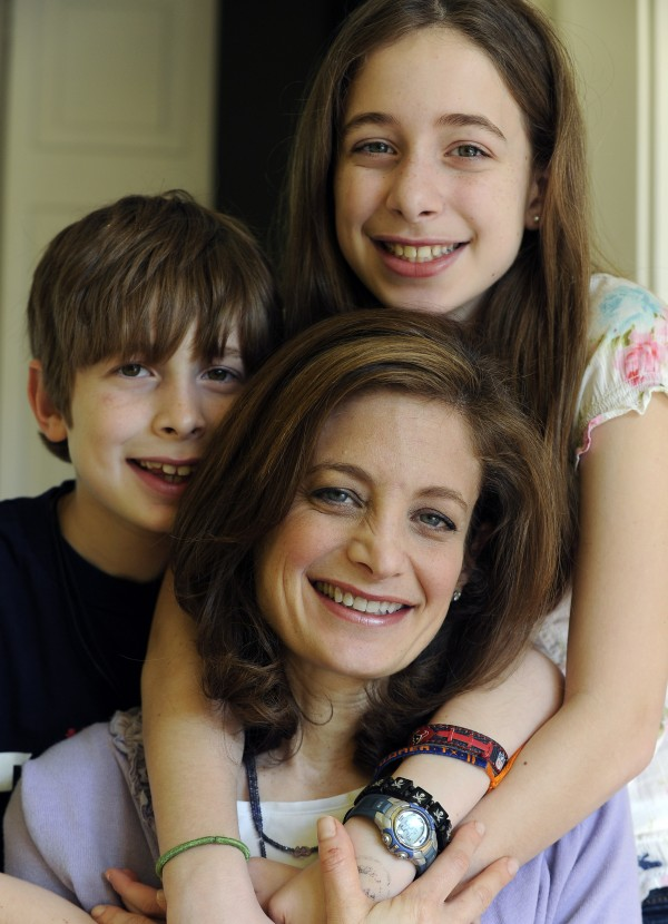 "In this March 12, 2012 photo, Bettina Siegel, center, poses with her son Asher, 9, and daughter Lily, 12, at their home in Houston. Siegel, whose blog ""The Lunch Tray"" focuses on kids'' food, was so upset over a report of ammonia-treated meat trimmings in school lunches she started an online petition asking Agriculture Secretary Tom Vilsack to ""put an immediate end to the use of 'pink slime' in children's school food."" As of Monday she had more than 175,000 online signatures."