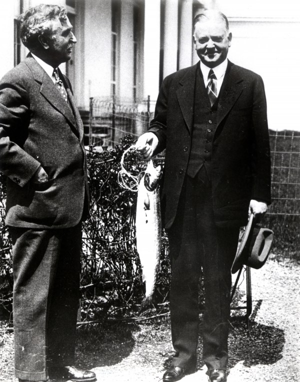 President Herbert Hoover (right) holds the 1931 presidential salmon caught by Horace Chapman.