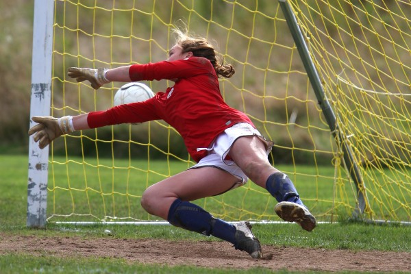 A ball gets past John Bapst's goalie Abby Pyne during their game against Presque Isle at the Dorothea Dix field in Bangor in October 2010.
