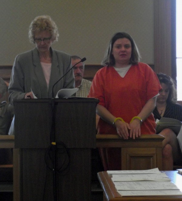Dyan Reeves (right) listens to her attorney speak during a sentencing hearing in Aroostook County Superior Court in Houlton on March 21, 2012. Reeves was initially sentenced to 90 days in jail on a drug possession charge last year, but was ordered to serve another 45 months on Wednesday for trying to smuggle drugs into jail.