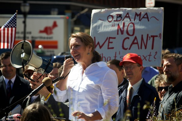 Leslie Sneddon of Richmond speaks through a bullhorn outside the federal courthouse in Portland on Friday at a rally against the Obama administration's  contraceptive insurance mandate.