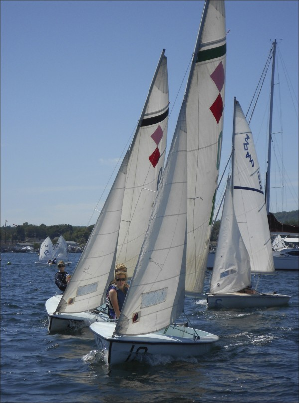 Tight maneuvering in 420 sailboats at the start of a Rockland Community Sailing race.