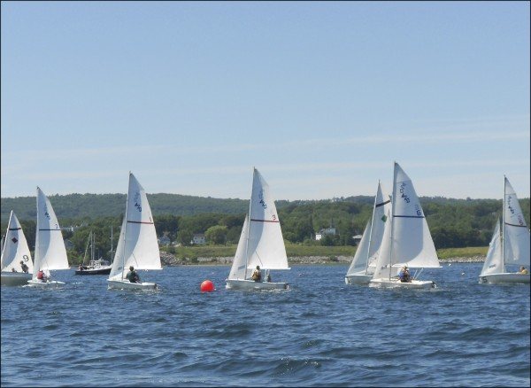 Youth sailors in 420 sailboats chase each other while racing at Rockland Community Sailing.