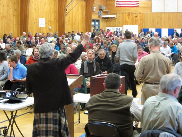 Searsport moderator Faith Garrold instructs residents on which ballot to use during Saturday's town meeting attended by more than 460 residents.
