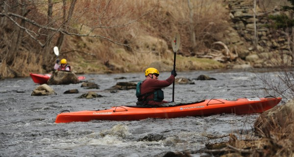 Kayakers competing in the St. George river race on Saturday, March 31, 2012 find themsleves stranded due to low water.
