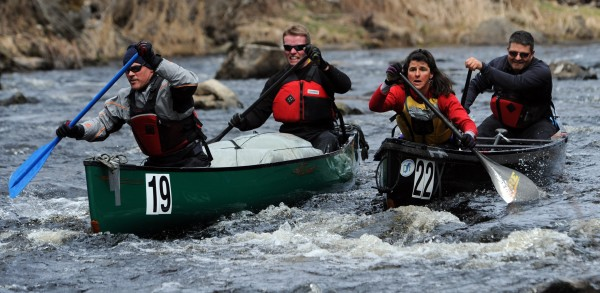 Participants in the St. George Canoe race struggle though low water on Saturday, March 31, 2012.
