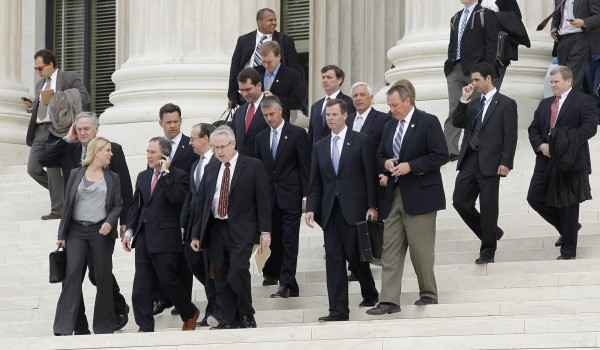 States' attorney generals walk down the steps of the U.S. Supreme Court in Washington on Thursday at the end of arguments on the constitutionality of the health care law signed by President Barack Obama.