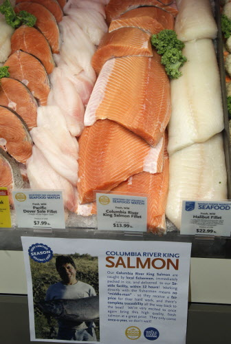 The seafood counter at Whole Foods Market in Hillsboro, Ore., is seen in September 2012. Whole Foods Market says it will stop selling fish caught from depleted waters or through ecologically damaging methods, a move that comes as supermarkets nationwide try to make their seafood selections more sustainable.