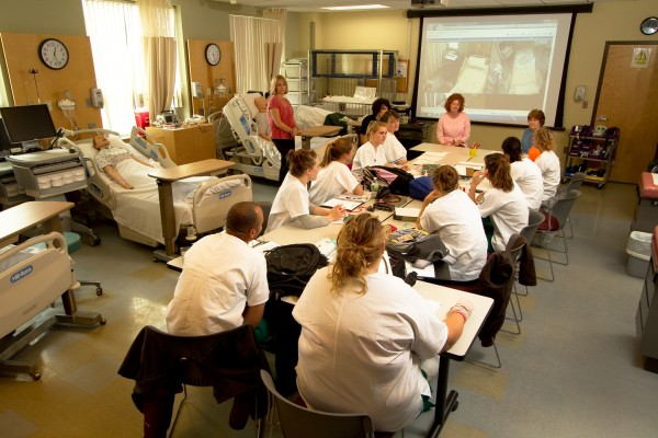 Husson University School of Nursing students are training using state-of-the-art technology in the form of a simulation laboratory. The lab allows students to practice their skills in a real world setting while also being monitored on camera by instructors.