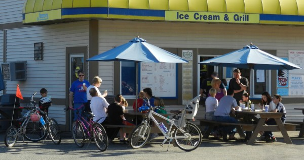 Sunday's record warm temperatures made for a big crowd at Jimmie's Ice Cream and Grill in Brewer. The parking lot was jammed and there weren't many places left to sit at the picnic tables and benches outside the ice cream shop on North Main Street.