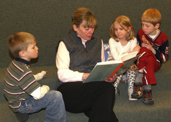 A volunteer from Belfast Senior College reads to second-graders during Read Across America.