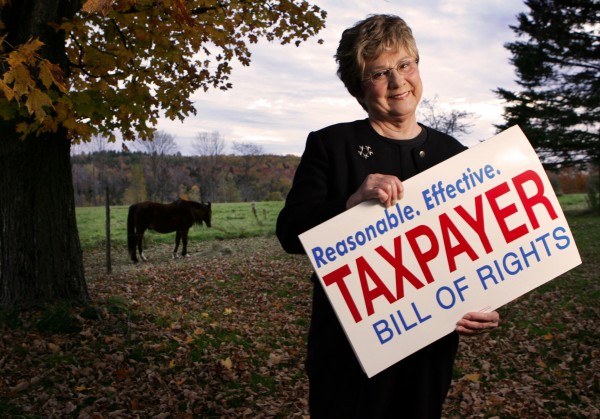 Mary Adams poses in her yard Tuesday, Oct. 10, 2006, in Garland, Maine. Adams, a 68-year-old grandmother, spearheaded the Taxpayer Bill of Rights initiative that aims to rein in government spending and cut taxes.